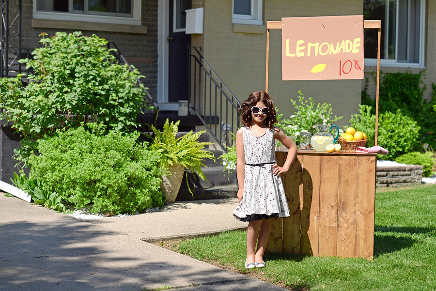 girl selling lemonade at home