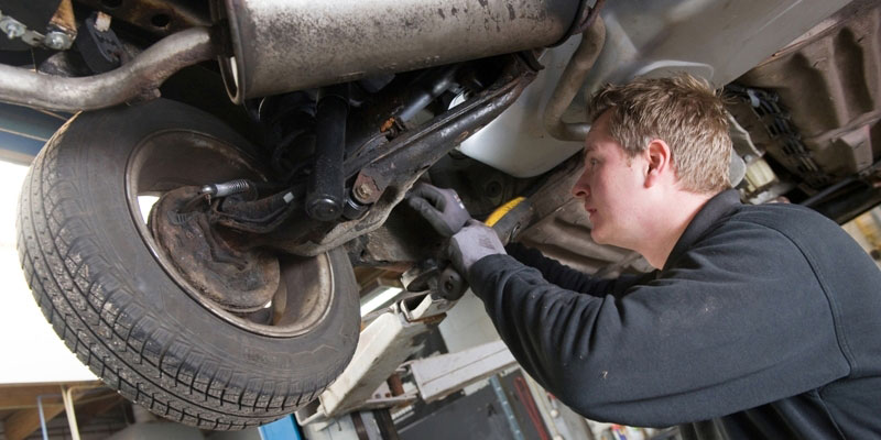A mechanic working on a vehicle