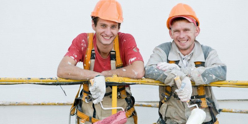 Two smiling painters
