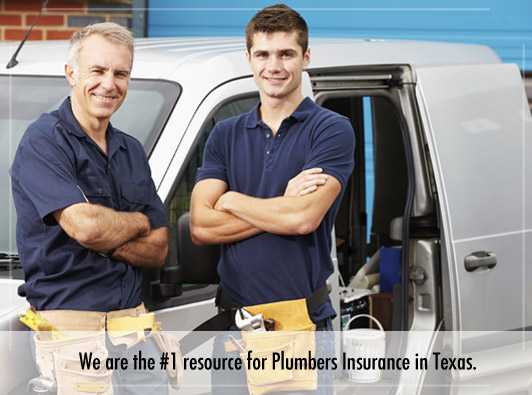 two plumbers smiling in front of a work truck